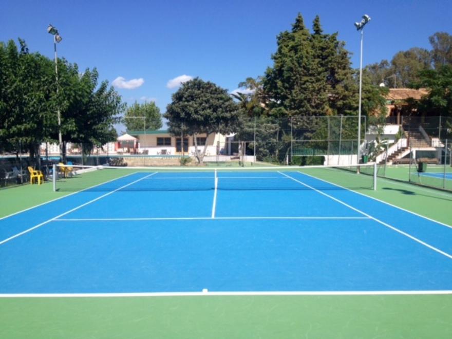 pista de tenis de resina azul y verde celabasa